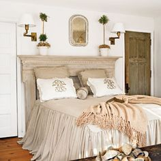 Neutral Bedroom: A damaged mantel serves as a headboard in the master bedroom. Because the small space doesn't allow for bedside tables, the homeowner installed sconces for nighttime reading.
