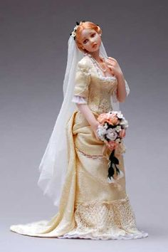 ANNA HARDMAN: Anna's wonderful miniature porcelain bride, Livia, made from her own original mold, was named a 2010 Doll of the Year Industry Choice Winner from Doll Reader Magazine.