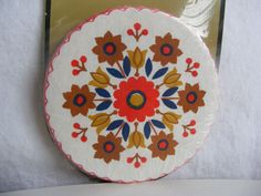 Scandinavian Folk Art Paper Coasters   could be a nice design on top of a covered dish