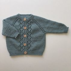 Elinor's Cardigan is knitted top-down with raglan increases on every other row down the yoke. The lace down both front bands is knitted from a chart. The ribbing is knitted on needle mm to mak… Baby Cardigan Knitting Pattern Free, Baby Boy Knitting Patterns, Knitted Baby Cardigan, Knit Baby Sweaters, Knitting For Kids, Girls Sweaters, Baby Knitting Patterns, Baby Patterns, Tricot Baby