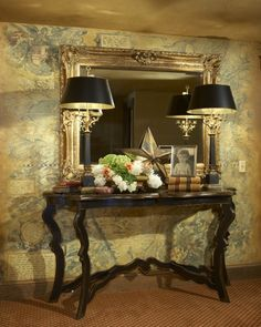 foyer with old world map wall covering