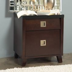 @Overstock - Crafted from solid tropical mahogany wood and cherry wood veneer, this nightstand features a built-in power outlet for your convenience. Satin nickel pulls and full-extension ball bearing drawer glides complete this nightstand.http://www.overstock.com/Home-Garden/angelo-HOME-Marlowe-Charging-Station-Nightstand/5989662/product.html?CID=214117 $184.49