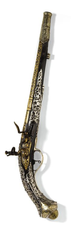 An Ottoman silver-mounted pistol with earlier gold-inlaid barrel, Turkey, circa 1700
