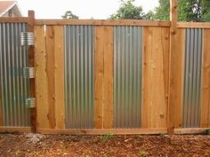 cedar and corrugated metal fence