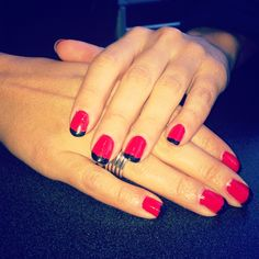 Red nails with black French tip manicure