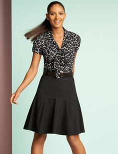Dress up a classic fit and flare skirt with a chic printed top.  #whbm #workkit