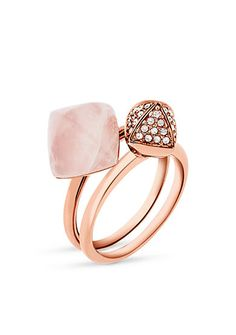 Stacked together or worn solo, these rose gold-tone Michael Kors Jewelry rings are major statement pieces. One ring is topped with a pave crystal-set pyramid stud, and the other with a pyramid-cut semi precious rose quartz stone.