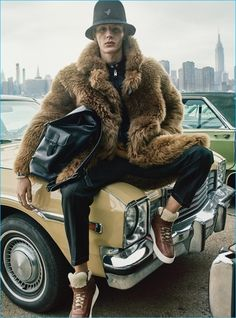 Model Finnlay Davis rocks a bucket hat and shearling coat for Coach's fall-winter 2016 advertising campaign.