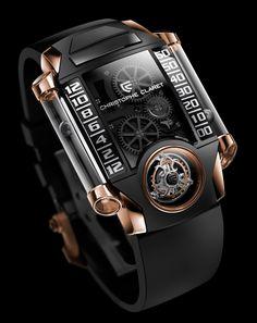 relojes de titanio.las bolas en los tubos laterales nos indican la hora. diseño fresco y super original