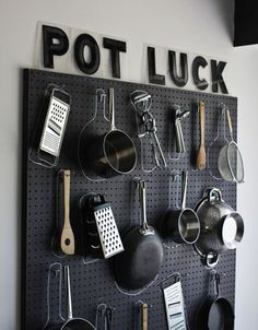 A bare, blank wall gets a stylish (and functional!) upgrade with a black pegboard.