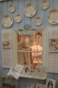 The mirror behind the window adds depth. Maybe near the front door with announcements hanging from shutters; Add a top shelf for the CD player; and paint the wall one of the shop's colors.