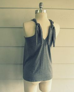 great reconstruct of a t-shirt to halter/tank top.. thirfty store here I come