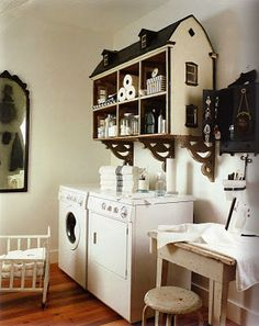 Old dollhouse as a wall shelf for storage. Fantastic!  This would bbe cute for a little girls room.