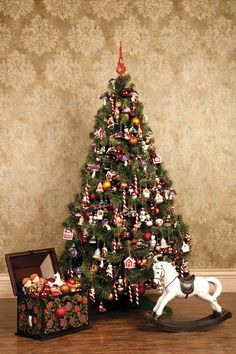 Beautiful Holiday Vignette with a toy box and riding horse and av lovely Tradional Christmas Tree!!! Bebe'!!! Love the variety of ornaments and peppermint sticks!!!