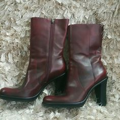Tommy Hilfiger Burgundy Leather Boots Wine or burgundy colored  leather boots with black under tones three inches heels. These boots are very beautiful and classy. A must have for your wardrobe. Boots are in like new condition worn once. Tommy Hilfiger Shoes Ankle Boots & Booties