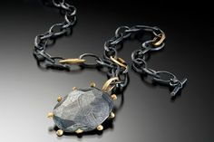 Necklace in .925 silver with patina and18k yellow gold by Dahlia Kanner Studio…