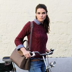 a button-up, a cable knit in a cranberry red, a neutral shoulder bag, and you've got fall all wrapped up.