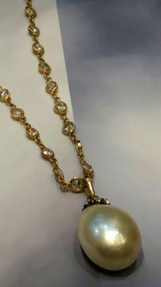 Art-Deco Natural saltwater Pearl and Diamond Sautoir Necklace. 1900 Natural Pearl 15mmX19.2mm, approx. 22 carats weight. Diamonds 7.5cts and gold chain 18K.