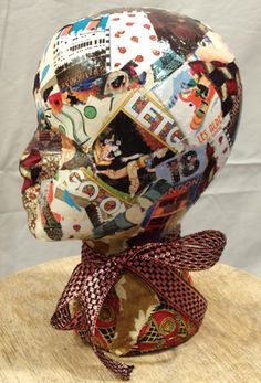 decoupage mannequin head....go now I understand why Hobby Lobby is selling old mannequin heads.. nice idea....hummmm...