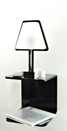 LampBED-shelf is the design bedside table with built-in lamp made of acrylic realized inside the SOB laboratory. The shelf is made of a single sheet of acrylic (10 mm. thick) hot-bent by hand, with a SOB's LampBED built-in. The appearance respects the principles of linearity and usability at the base of SOB's design.
