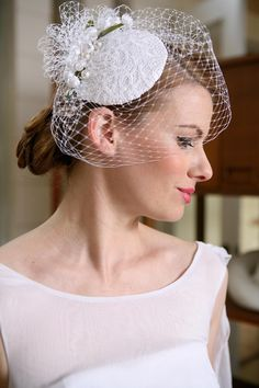Little Hat with birdcage veil: Fine French netting and unique materials. Available in champagne with ivory lace overlay and champagne netting, ivory with ivory lace/netting, and white with white lace/netting.