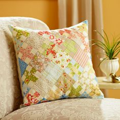 One simple block in assorted fabrics yields a knockout throw pillow. Fabrics are from the California Girl collection by Fig Tree & Co. for Moda Fabrics.