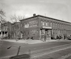 """""""Rowhouses and moving company."""" Circa 1925, the furniture and hauling business of Sam Madeoy at 600 H Street N.E. National Photo Company."""