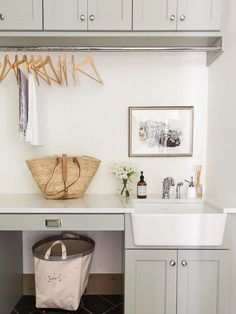 Modern Farmhouse Mudroom & Laundry Room with Sage Cabinets + Farmhouse Sink via House of Jade Interiors // Laundry Room Ideas, Decorating Ideas, Mudroom Ideas, Interior Design, Modern Farmhouse Mudroom Laundry Room, Laundry Bin, Laundry Room Remodel, Farmhouse Laundry Room, Laundry Room Organization, Laundry Room Design, Laundry Basket, Organization Ideas, Laundry Room Sink Cabinet