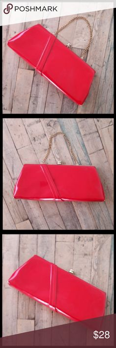 Awesome vintage 60's bright red patent bag! This bag is so fun! Overall in great shape with only a few makeup stains inside and a few white scuffs that are hardly noticeable. Measures 12x5x2.5. Has a clasp closure and a chain handle. Can also be used as a clutch if you tuck the handle inside. Very mad men, rockabilly style. Vintage Bags