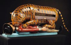 Tippoo's Tiger is one of the Victoria & Albert Museum's most quirky and popular exhibits. It was made for Tipu Sultan, ruler of Mysore in South India (1782-1799) and consists of a tiger mauling a prostrate figure in European clothes. An organ is concealed inside the tiger's body, and when a handle at the side is turned, the organ can be played and the man's arm simultaneously lifts up and down. Intermittent noises are supposed to imitate the wails of the dying man.