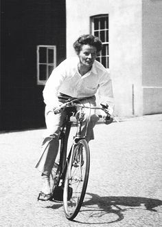 Katharine Hepburn riding her bike in Hartford, Connecticut, 1952