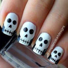 How cute are these skull nails by They're perfect for Halloween! You can also watch her video tutorial to see how to create this simple skull nail art. How are you wearing your nails for Halloween? Cute Halloween Nails, Halloween Nail Designs, Halloween Skull, Diy Halloween, Google Halloween, Women Halloween, Halloween Makeup, Skull Nail Art, Skull Nails