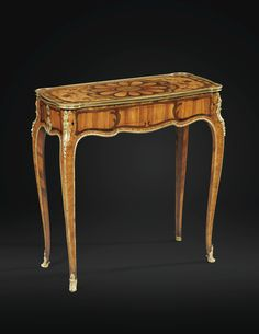 "TABLE MECHANISM CALLED ""SLIDING TABLE"" INLAID AND BRONZE GILDED LOUIS XV, ATTRIBUTED TO JEAN-FRANÇOIS OEBEN, 1750 A GILTBRONZE MOUNTED MARQUETRY TABLE MECHANICS, LOUIS XV, ATTRIBUTED TO JEAN-FRANCOIS OEBEN, CIRCA 1750"