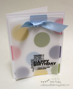 The background paper can be a colorful printed paper or a collection of stamps.  Punch two holes at the tip and tie a piece of clear vellum to the front.  Attach both to your card front and you have a clearly unique handmade birthday card.