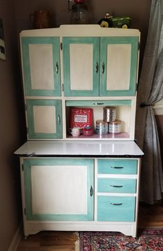 Mud room with refinished Hoosier cabinet, handmade pennants and ...