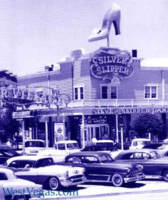 The Silver Slipper High Heel Sign/The 'Silver Slipper Saloon' added a large, light bulb covered, high-heeled, woman's shoe sign to its roof.  The 'Silver Slipper' was one of the most famous of Las Vegas signs. Like 'Vegas Vic', The 'El Rancho Windmill', the 'Dunes Sultan', 'Aladdin's Magic Lamp', 'Hacienda's Cabelero', 'Sahara's Camels', Caesars' Centurions', 'Thunderbird's neon Thunderbird', and the boot-kicking 'Sassy Sally' this iconic-object sign remains a long remembered part of Old…