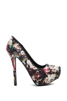 Make a bold statement in these darkly romantic floral pumps! Featuring an allover bold floral print in a black grounding, almond toe, and concealed platform. High stiletto heel. Leatherette piping.