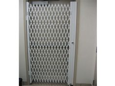 Double Diamond Folding gate for door Security - Glassessential.com  http://www.glassessential.com/security-scissor-folding-gate  #folding #gate #door #foldinggate #expandable #collapsible #security #expandablegate #collapsiblegate #securitygate #storefront #patio #divider #enclosure #storage #access #accesscontrol #shipping #receiving