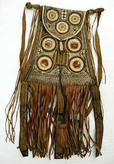 non-westernhistoricalfashion: bag leather/ wool Hausa Acquired in Nigeria by the museum in 1935: