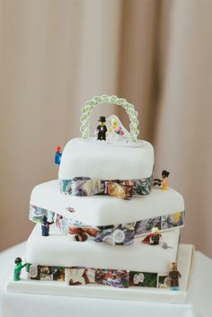Lego bride and groom, Lego Avengers and comic book ribbon decorated wedding cake.