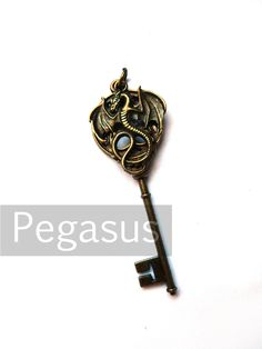 Dragon Tamer Skeleton Key (1 Pieces) Serpent Dragon on bronze key pendant for chokers, wedding favors, steampunk jewelry, and gift. via Etsy.