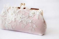 The bridal bag is made of heavy blush pink satin and wrapped around with a layer of embroidered tulle lace and adorned with an embroidered lace appliqué of magnolia flowers and branches.  Clutch bag is mounted onto a light rose gold clutch purse frame.The clutch bag measures:Length: 9 inches acrossHeight: 5 inches from top to bottom Depth: 2.5 inches front to backThere's a small inner pocket that would fit a Samsung Note or an iPhone, money or small change. The bag is padded and fully...