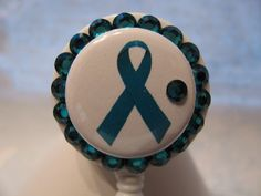Teal Ribbon Ovarian Cancer Awareness ID Badge Holder Retractable Reel with Charm by sparklinghope on Etsy https://www.etsy.com/listing/245849354/teal-ribbon-ovarian-cancer-awareness-id