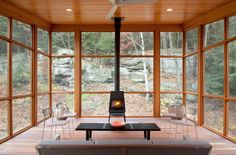 Although the porch can't be enjoyed in the dead of winter, the architects extended its usability by installing a wood-burning stove.