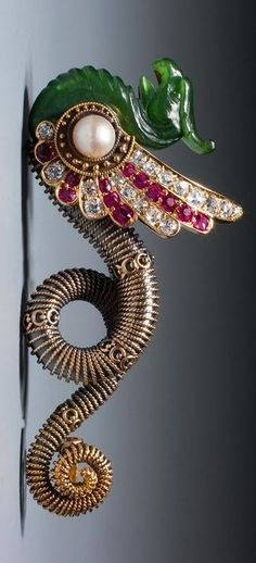 A very unusual Antique Revival gold, jade, ruby, diamond and pearl brooch