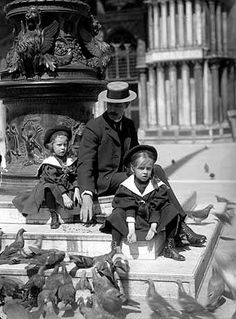 Nice old picture of well dressed kids, complete with stylish hats sitting near the Basilica in St. Mark's Square.