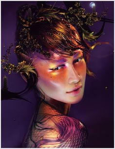 One of the most artistic, not to mention gorgeous, cosmetic ads I've seen in a while. MAC Year of the Snake Collection for Spring 2013.