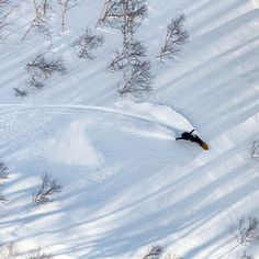 Makato Yamada plays with light and shadow in the Niseko, Japan backcountry. #japan #snowboard