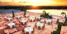Gorgeous sunset wedding reception dinner setup at Beach Palace overlooking the Caribbean in Cancun, Mexico | Palace Resorts #destinationwedding