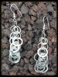Hammered Dangle Circle Earrings   Flashy with style, hammered from 16 gauge argentium silver, these dangle earrings are approximately 2¼ long and 1¼ inches wide.    $80.00